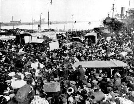 Refugees in Antwerp crossing bridge